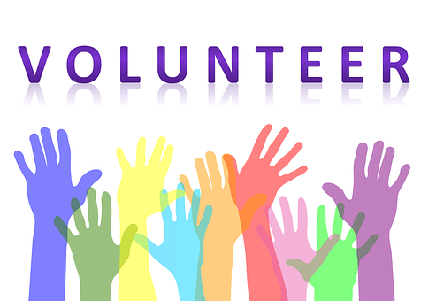 volunteer logo showing hands in the air